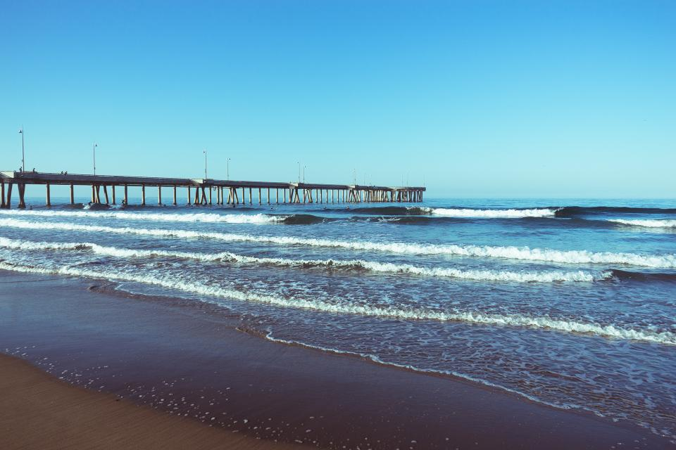 pier beach sand shore water ocean sea waves sunshine summer sunrise blue sky