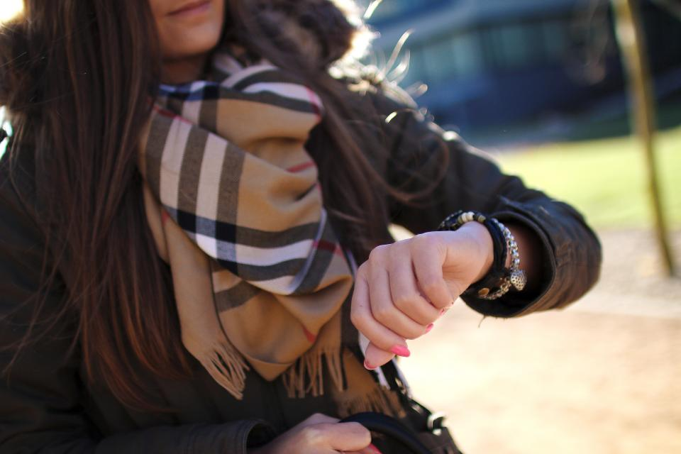 watch time bracelet hand young girl woman fashion scarf burberry brunette people jacket cold