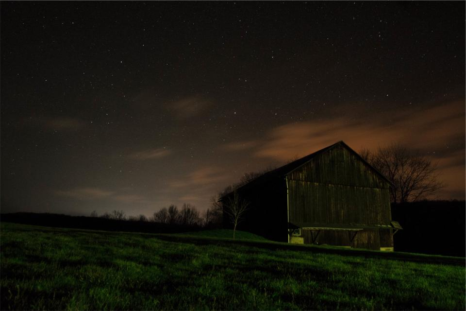 dark night sky stars barn grass fields country rural barn