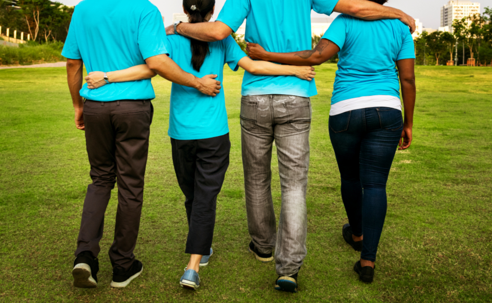 arms around charity cheerful chinese community community service diverse donation environment european friends friendship grantor group happiness humanity