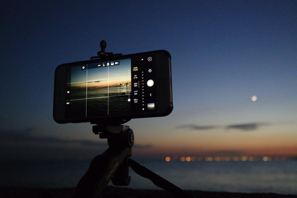 tripad camera mobile phone modern technology electronics view blur sky sunset sea water nature photography
