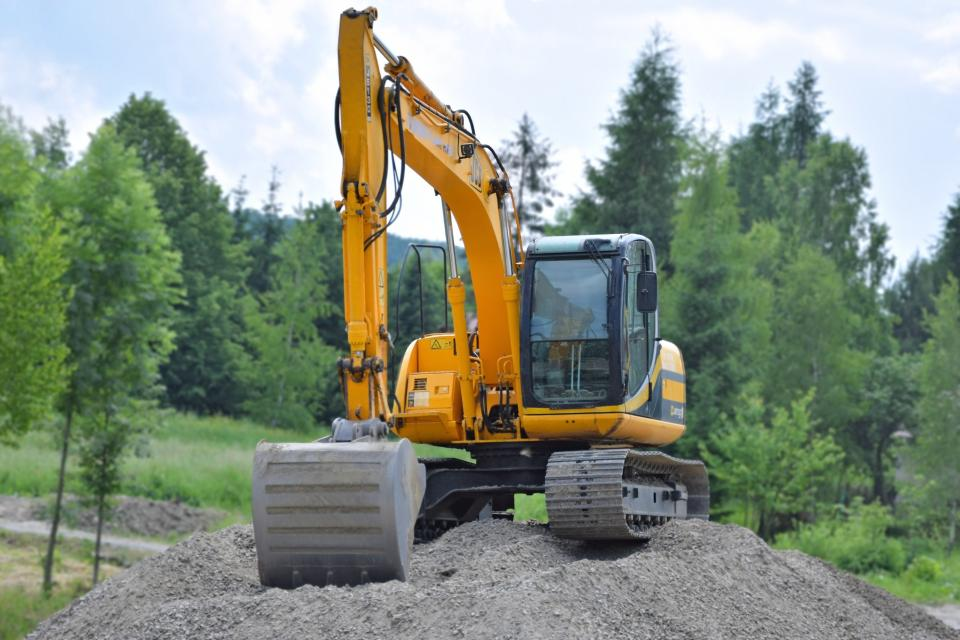 green trees plant nature sand heavy equipment vehicle yellow excavator