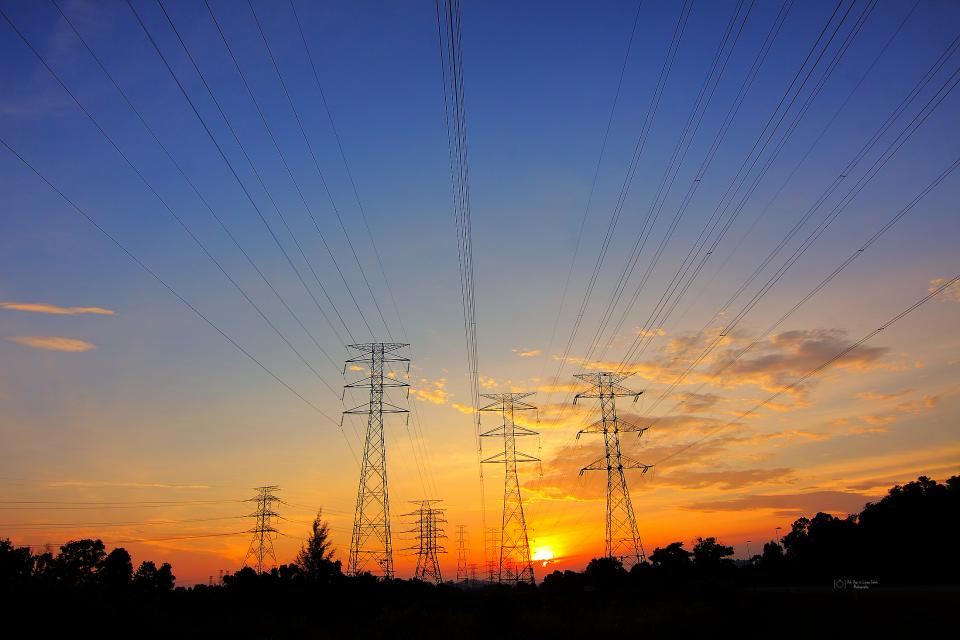 transmission line clouds sky trees plant sunset dark silhouette electricity