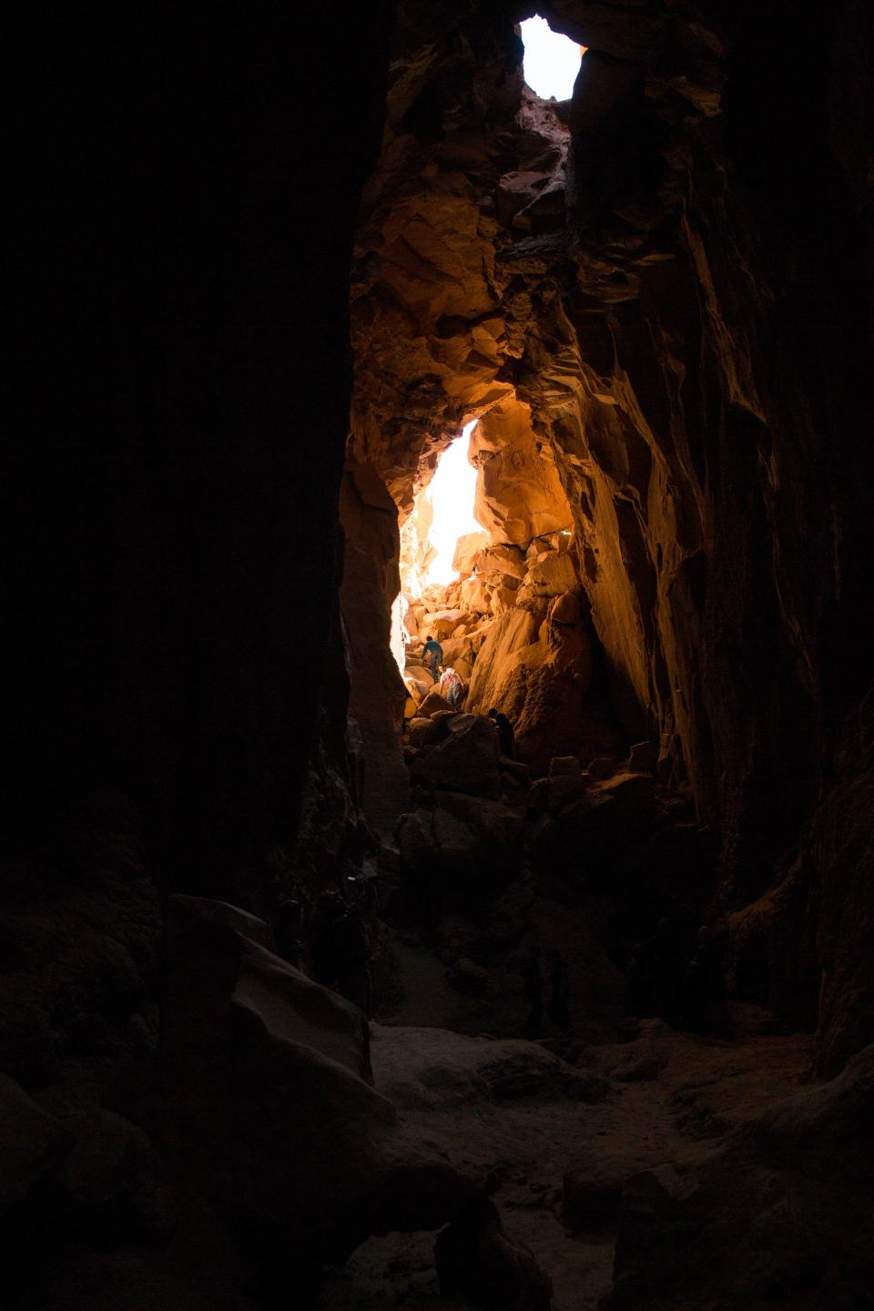 nature cave travel adventure rock stone dark sun people man alone