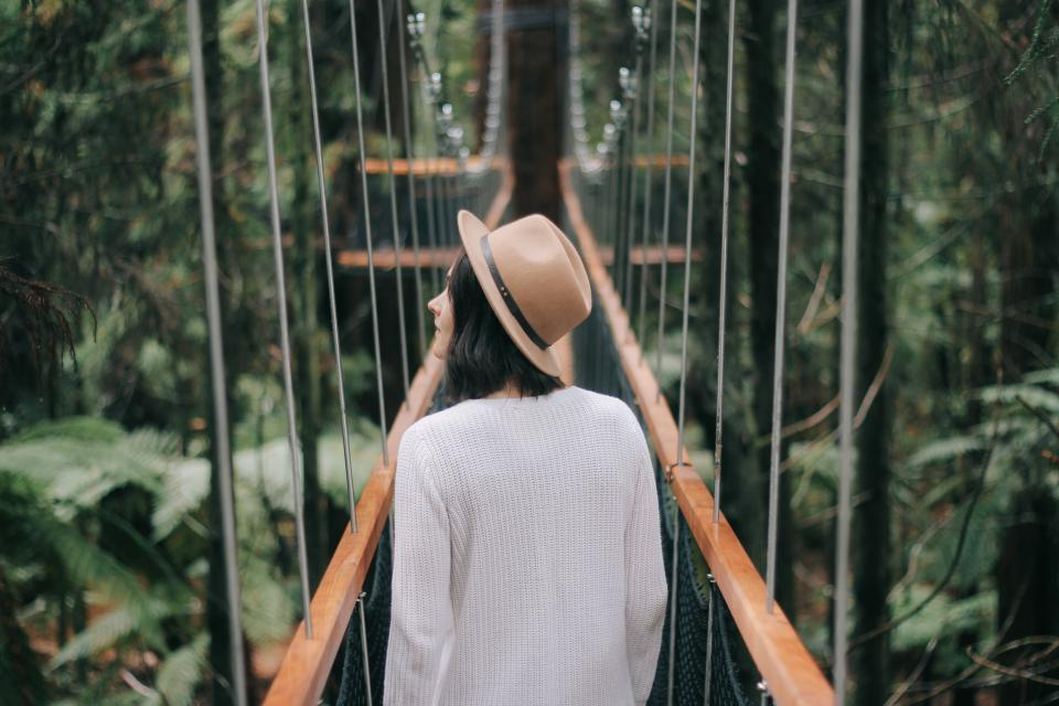 people girl woman travel walking alone hat nature plants bridge trees