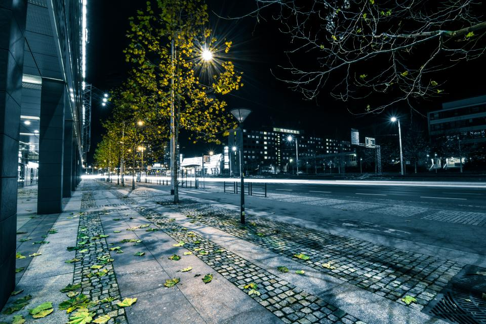 streets roads lamp posts night dark evening city urban buildings sidewalk