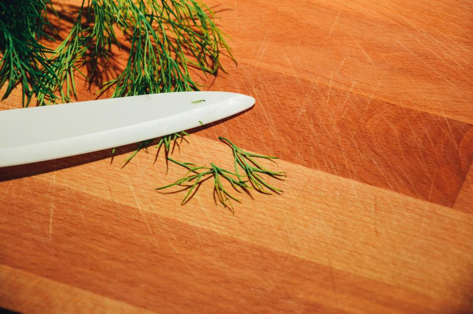 dill herbs knife cutting board kitchen chef food