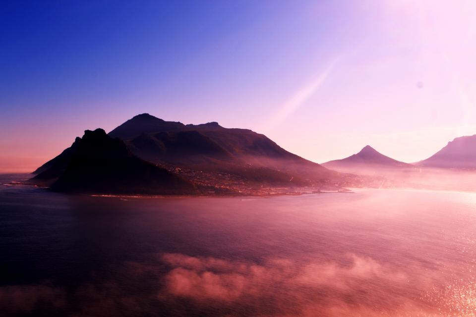 mountain highland clouds sky summit ridge landscape nature valley view sea ocean water