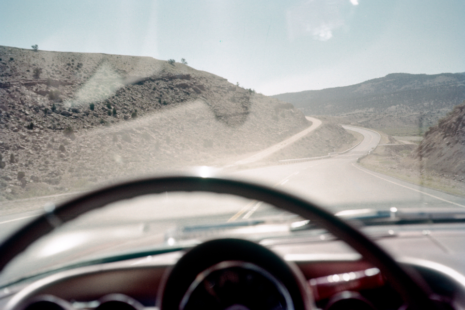 highway car vintage road america landscape auto horizon travel film photography retro usa sky dashboard old mountains clouds steering wheel