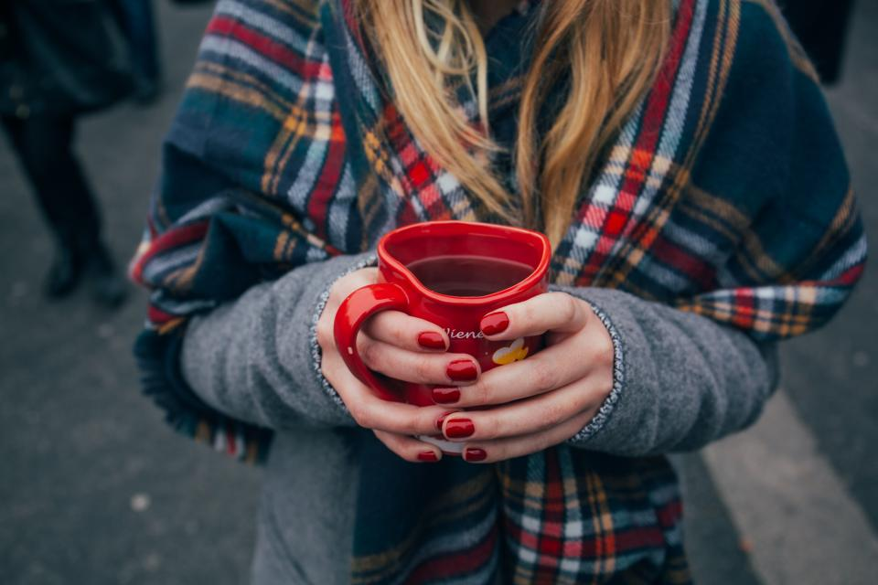 red mug cup coffee drink hand people girl cold weather jacket shawl