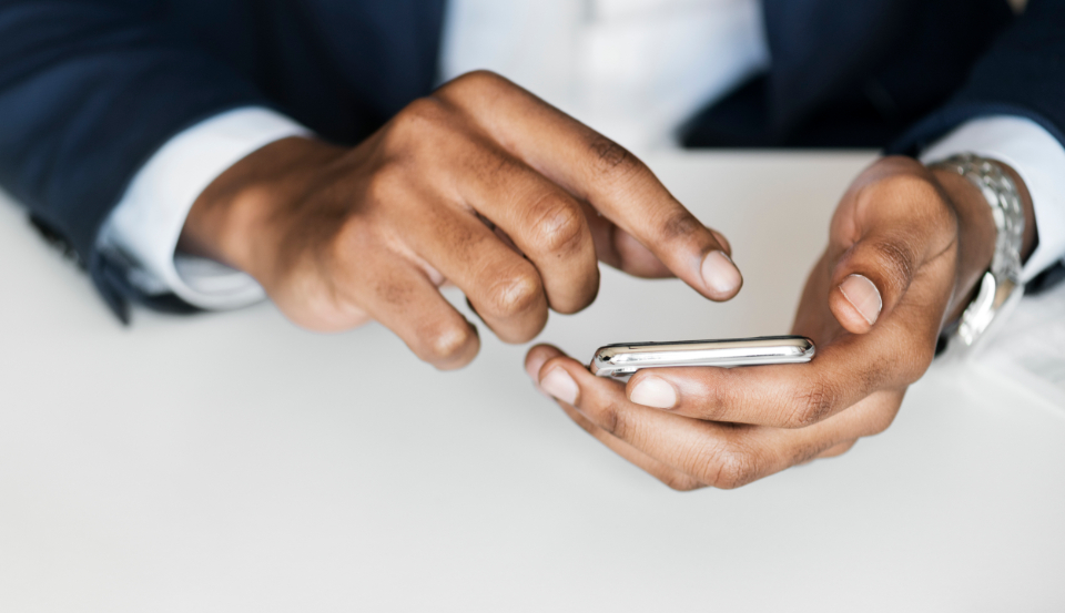 businessman cellphone closeup communication connection device digital device hands internet media mobile mobile phone network nigeria nigerian office online