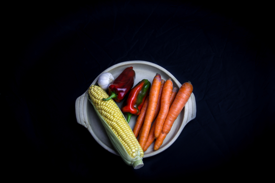 isolated vegetables plate carrots corn peppers garlic top garden fresh ingredients cooking dinner healthy diet food organic natural agriculture flat lay raw