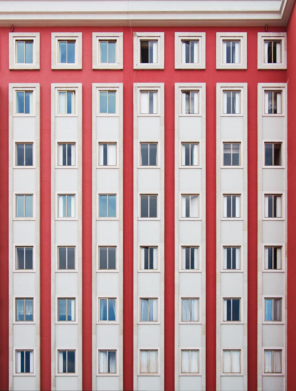 architecture building apartment windows condominium symmetry red wall