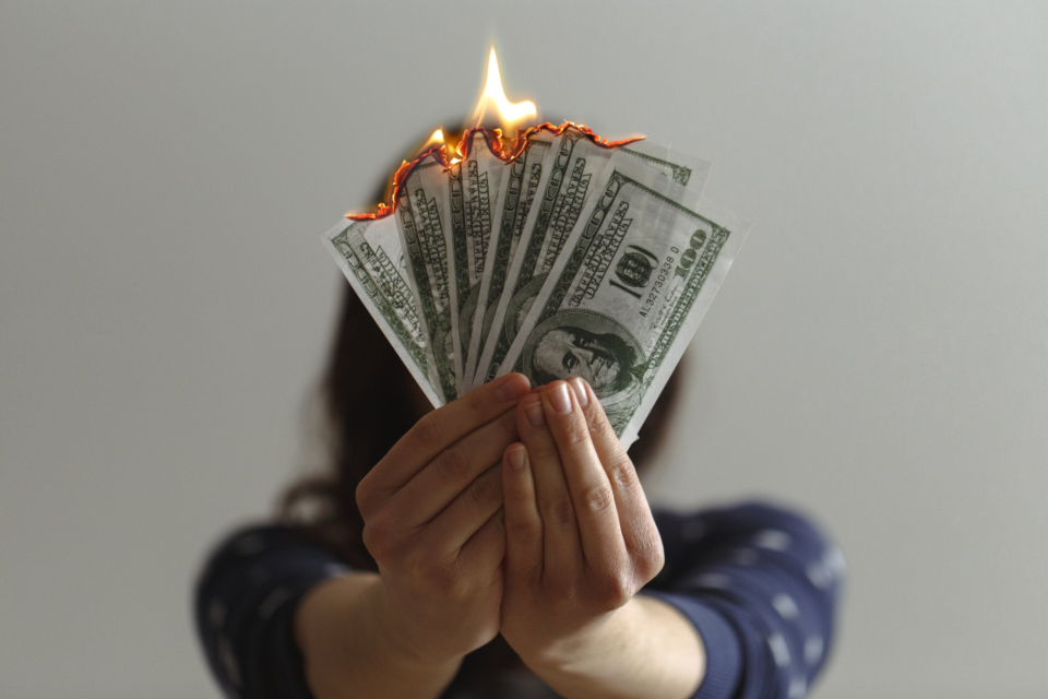 hand holding bills currency financial rich background close up isolated bank business debt loan success wealth fire burning money cash economy wasteful