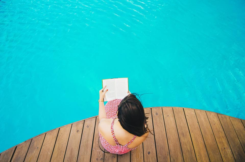 Hot for Teacher Repatriation Dating Diaries swimming pool blue water wooden people girl woman reading book relax travel vacation