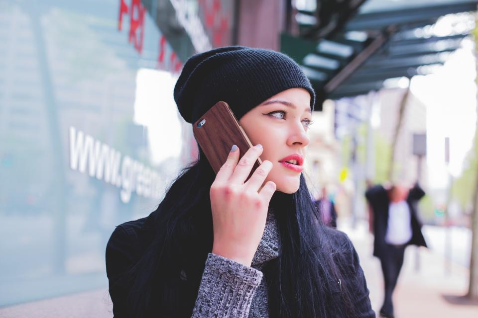 people girl beauty mobile phone talking communication gadget technology city blur
