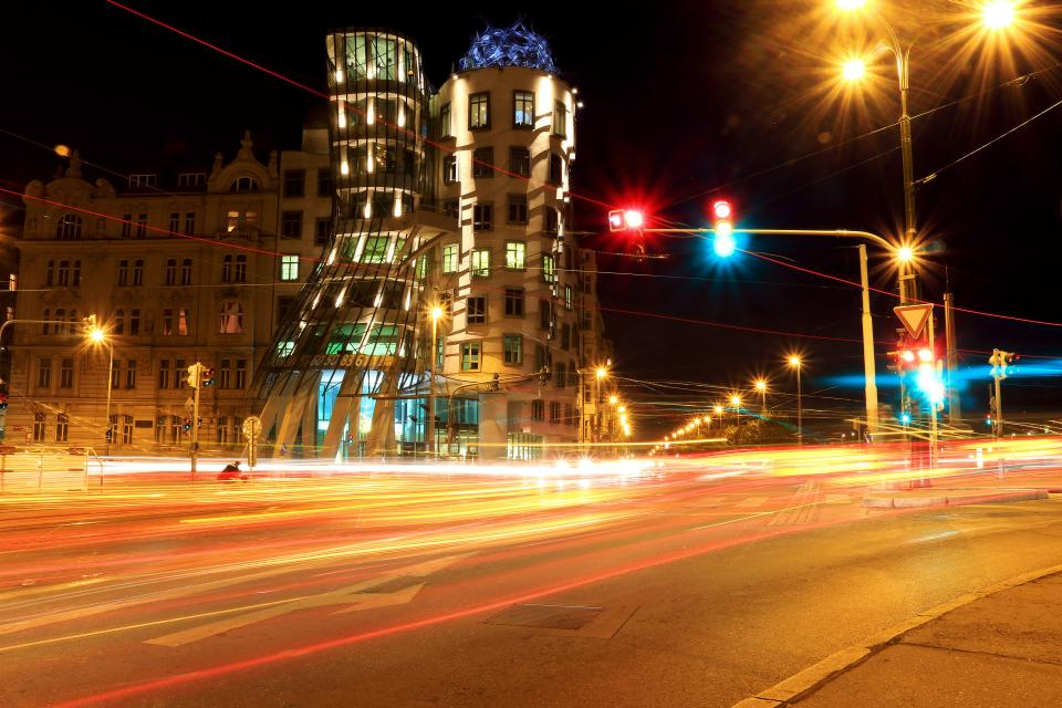 Prague city urban street road lights intersection lamp posts buildings architecture night evening