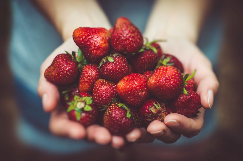 food eat fruits strawberries woman girl people hands picked bokeh red