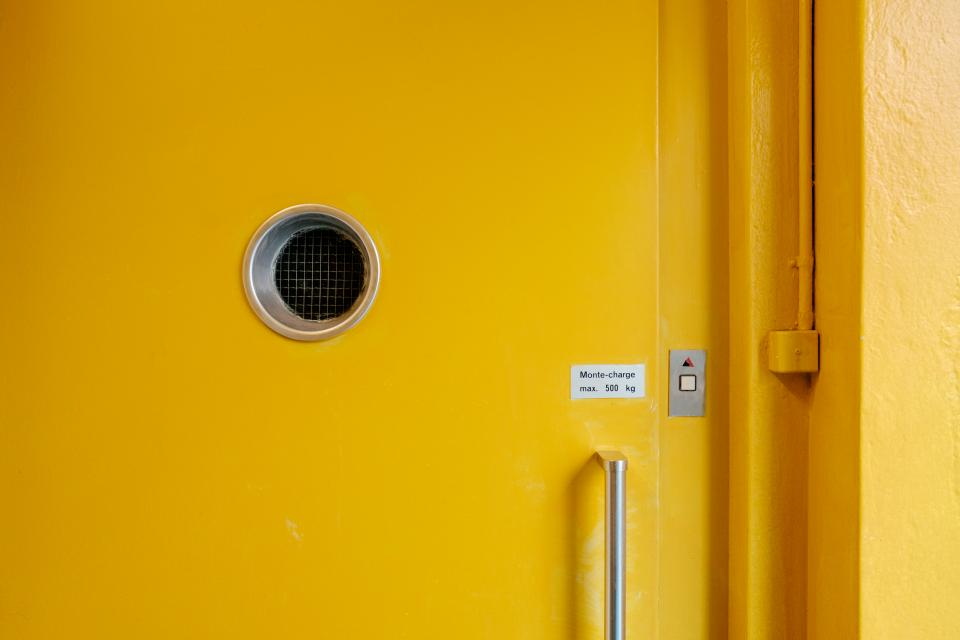 yellow door hole wall