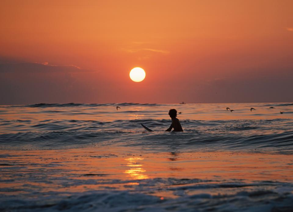 nature sunset sun surf beach ocean sea doves bird man people silhouette water beach travel