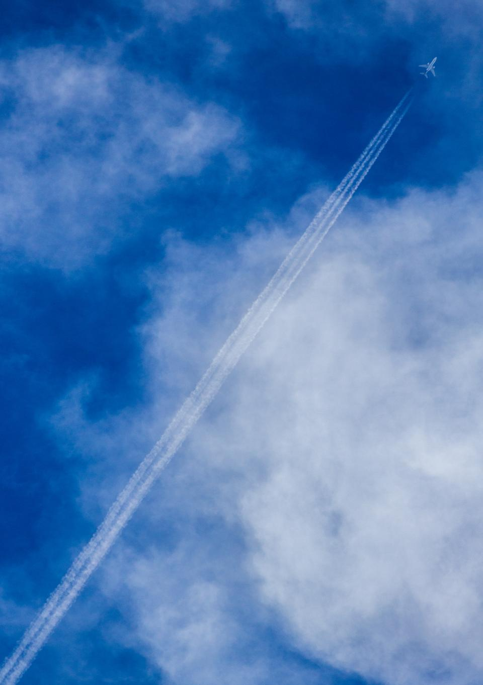 blue sky clouds airplane flying travel transportation contrails