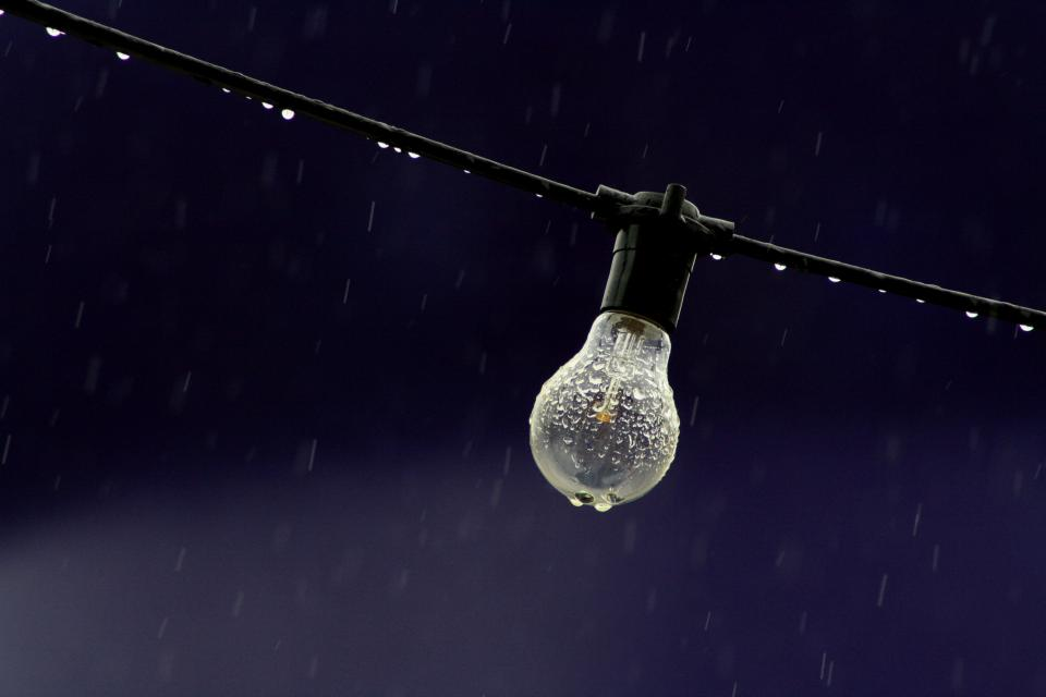 electric light bulb wire rain raindrops water droplets bokeh still