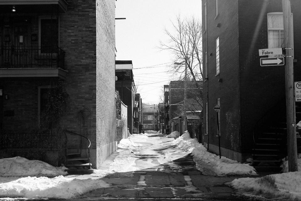 street snow building apartments houses one way sidewalk residential fabre black and white
