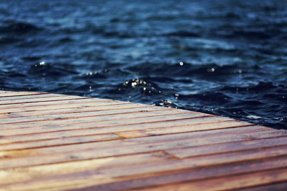 wood dock water waves ripples