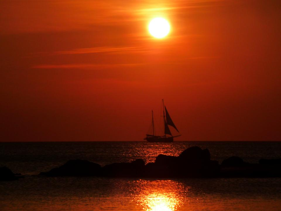 sunset sailboat water ocean sea red sky