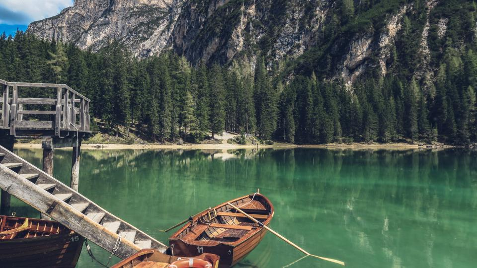nature landscape mountains forests trees vegetation water coast shore lake river reflection dock wood stairs boats paddles