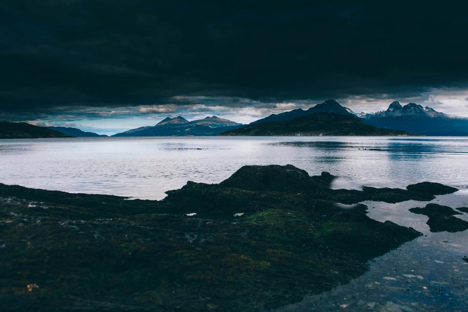 sea ocean water wave nature view mountain highland landscape dark sky cloudy outdoor travel