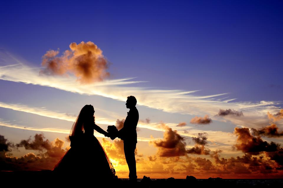 Maldives sunset wedding bride tropical island atoll beach lagoon sea groom bouquet couple bridal silhouette sky clouds dusk