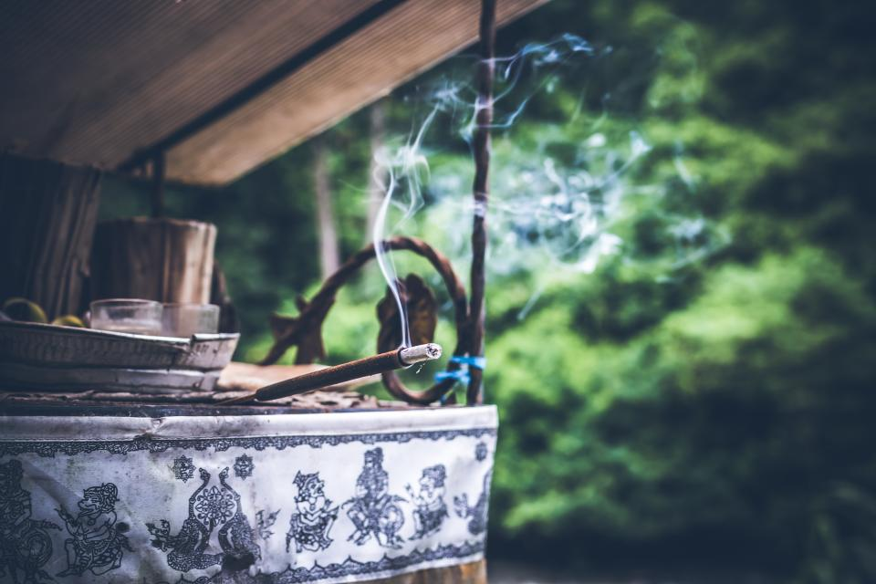 smoke smell incense stand stick blur environment outdoor tree wood