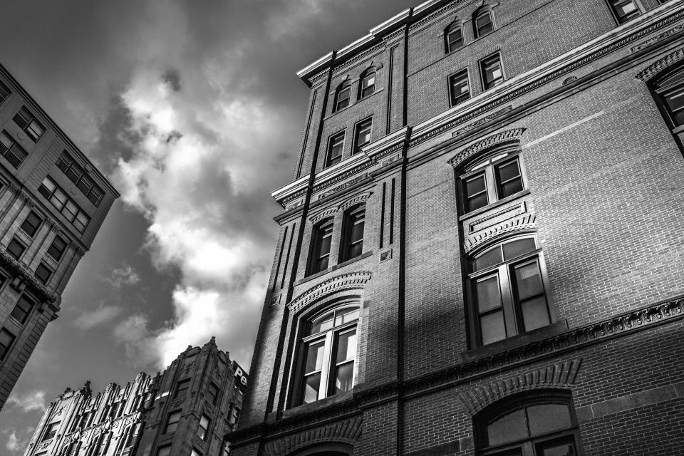 buildings bricks wall windows city town sky clouds architecture