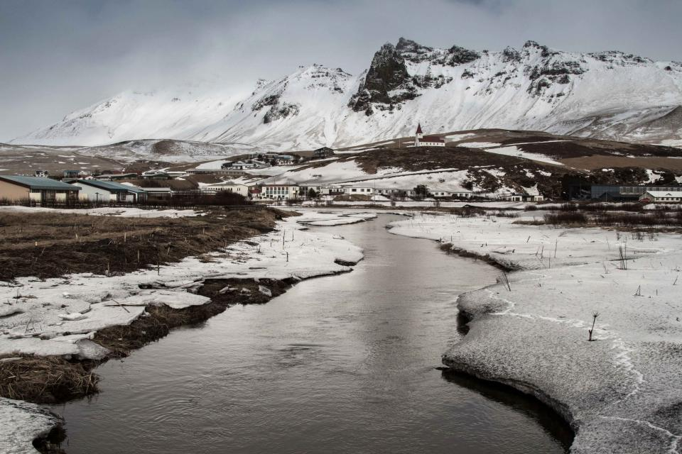 river water ice snow winter cold mountains peaks city town landscape