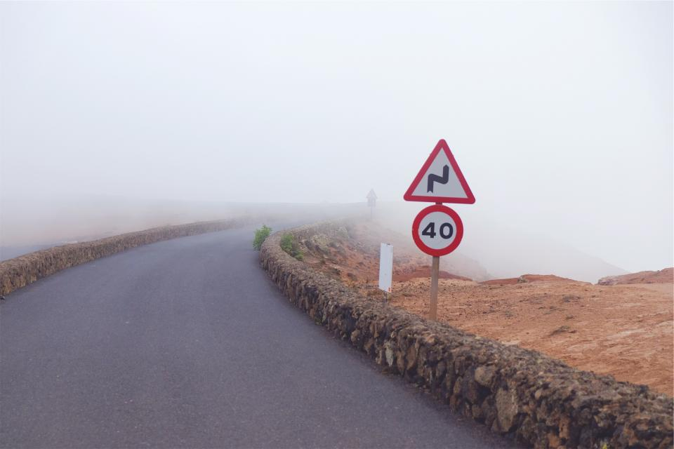 road fog signs speed limit pavement
