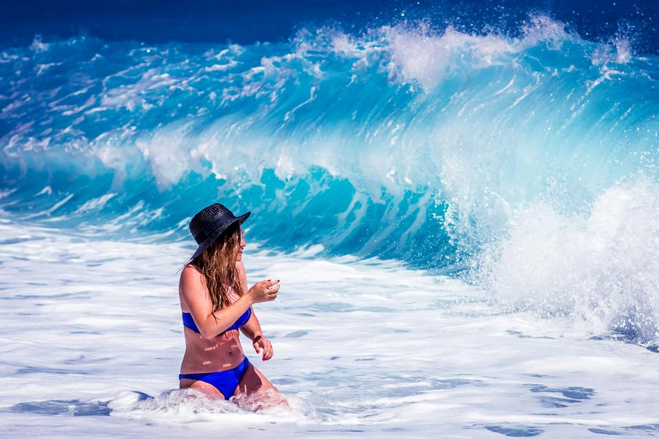sea ocean blue water waves nature people girl woman swimming suit travel