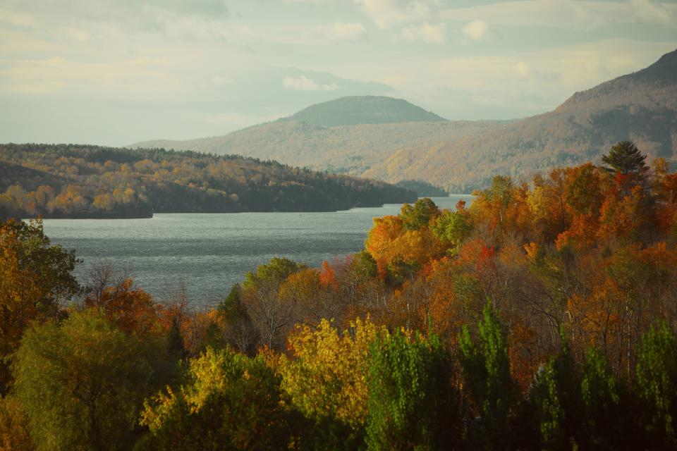 lake water nature outdoors landscape autumn colors trees forest mountains hills sky