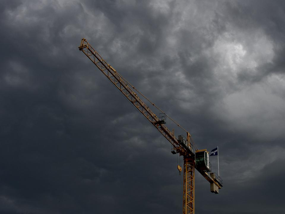 crane construction industrial sky storm clouds cloudy