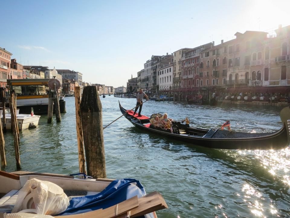 gondola Venice Italy water docks buildings houses apartments architecture couple family romance romantic boats