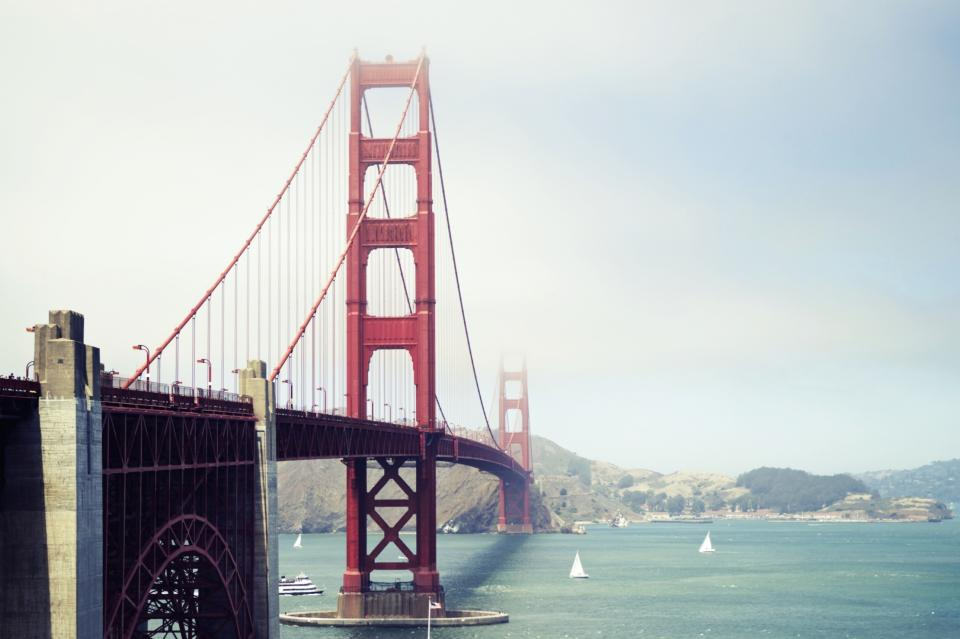 golden gate bridge red architecture water sailboats coast mountains hills san francisco usa united states sky clouds sunny