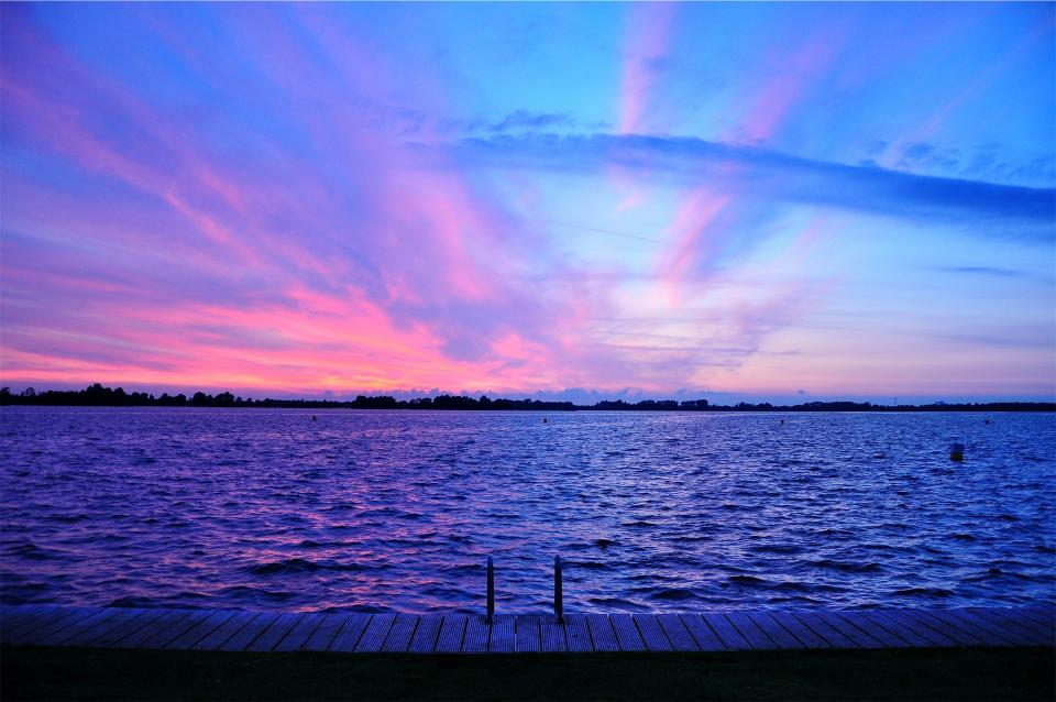 purple sunset dusk sky pink lake water dock clouds