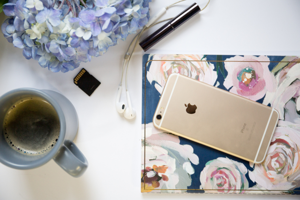 top workspace office coffee cup smartphone technology business phone freelance flowers flat lay desk earbuds lipstick