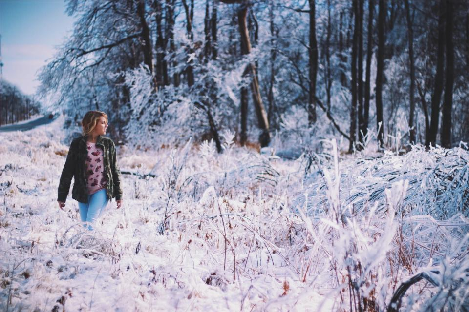 young woman girl jacket jeans denim winter cold snow ice frozen freezing trees forest woods nature rural road people