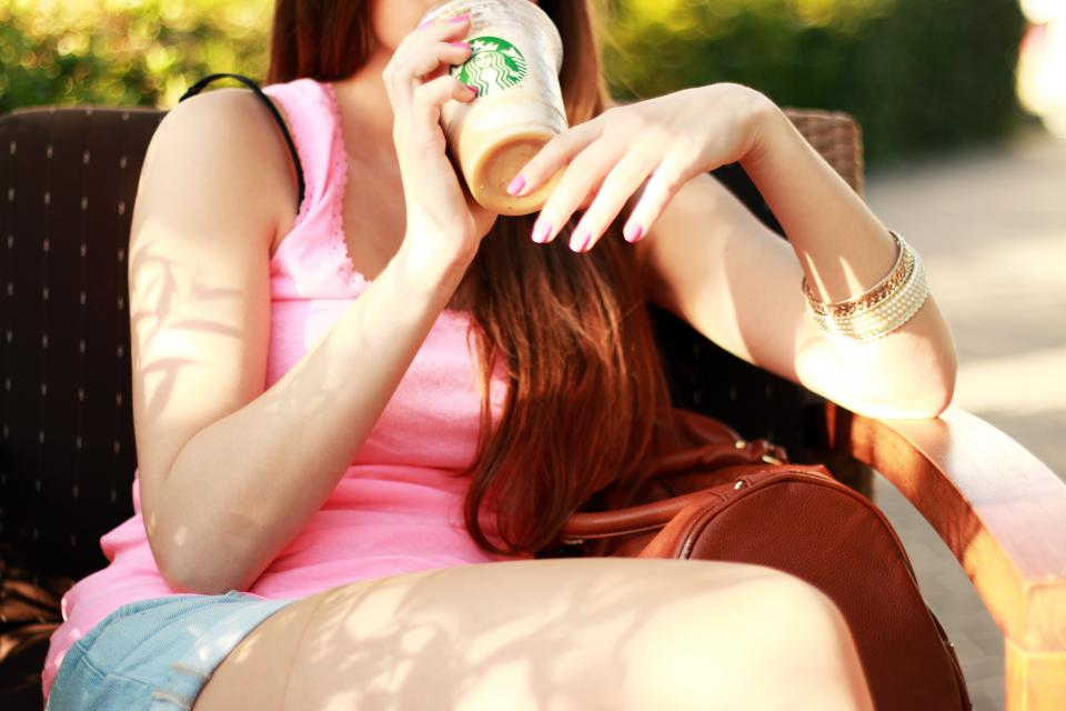 young girl shorts tank top starbucks coffee drink beverage hands fingers nail polish bracelets cute pretty