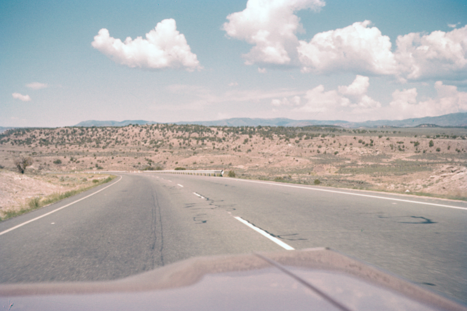 highway speed road vintage america landscape horizon travel film photography retro usa sky old automotive driving clouds