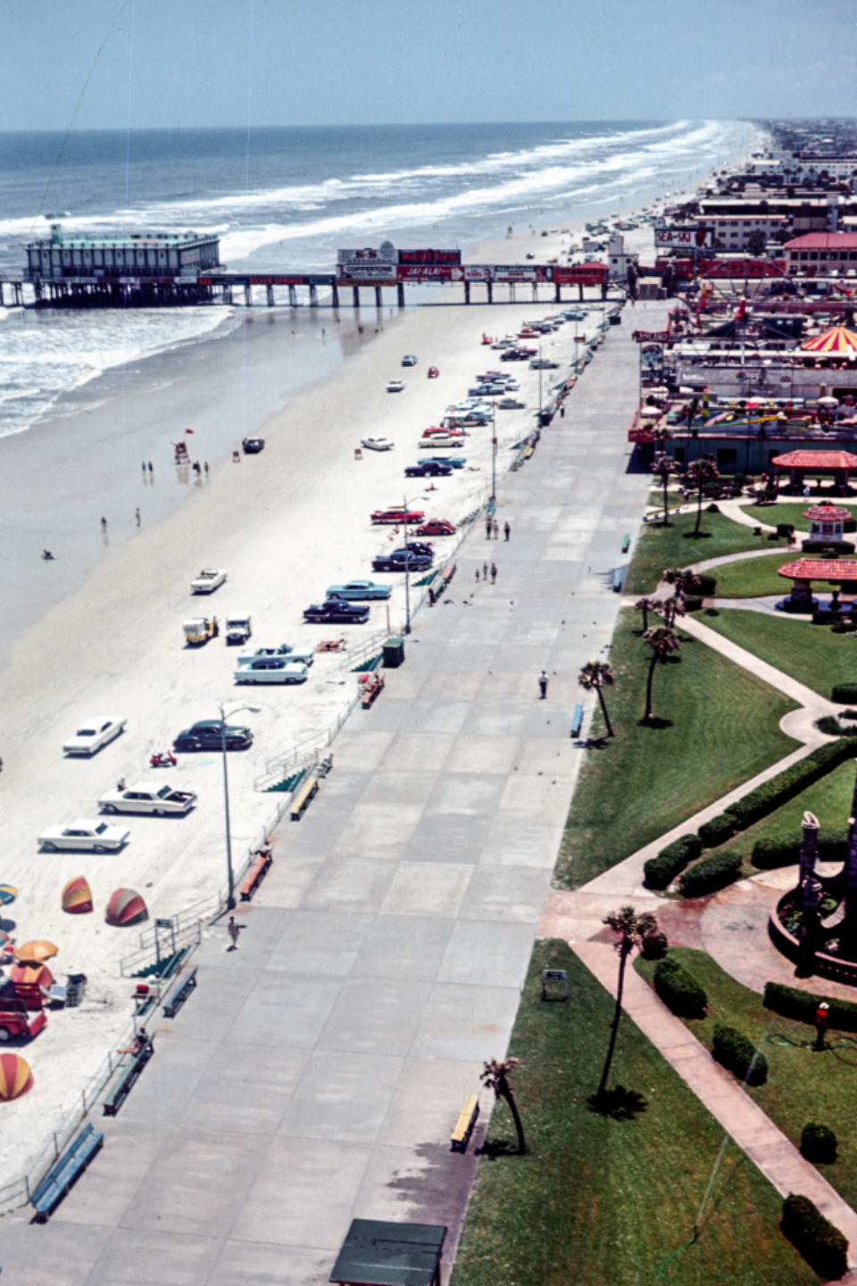 beach cars coast pier crowd people retro view autos vacation travel sky ocean sand fun vintage film walk vendors