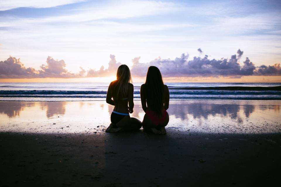 women girls ladies people friends bonding swim beach shore sand water ocean sea wave sky clouds horizon dusk dawn shadows silhouette gradient