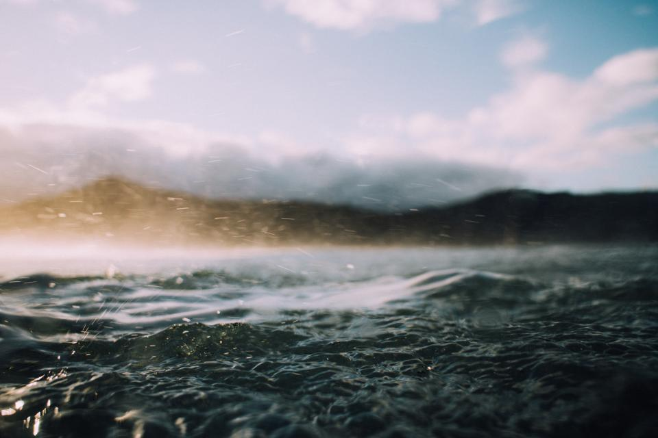 sea ocean water waves nature blur mountain sky