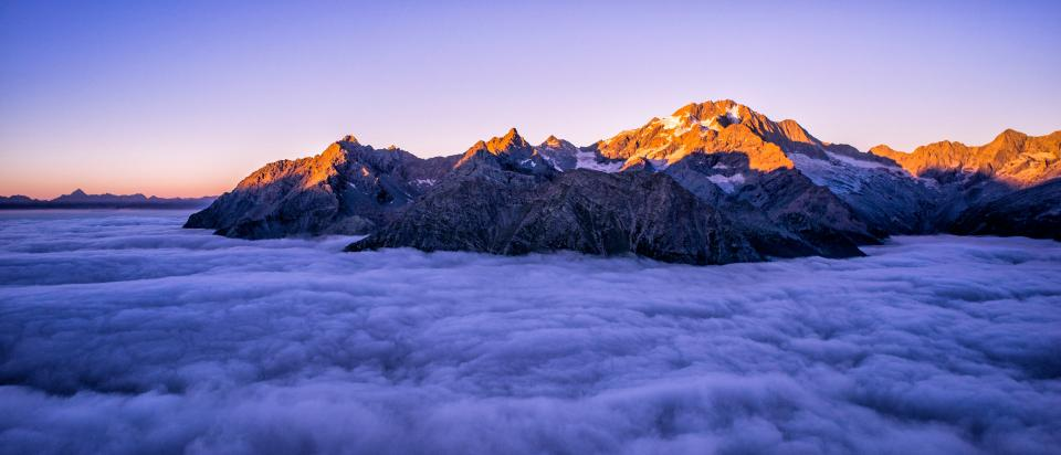 clouds sky sunny day mountain summit peak valley landscape nature